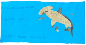 Scalloped Hammerhead Shark by John D, Bharath J, Jason L, and Diego R. Ms Harad's 6th grade class, Thomas Starr King Middle School, 2014. Painted and embroidered fabric appliqué with rubber stamps.